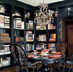 It's a bit dark and gothic, but I love the idea of fusing a formal dining room with a library.