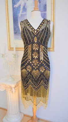 This is a FABULOUS style GREAT GATSBY beaded flapper dress. Color is BLACK over a champagne slip with Black and Iridescent Beadwork. Dress is fully beaded with black and iridescent beadwork that gives off rainbow colors in certain lights! 1920s Fashion Dresses, 20s Dresses, Bridesmaid Dresses, Flapper Dresses, Bridesmaid Ideas, Bridesmaids, Vintage Outfits, 1920s Outfits, Fashion Vintage