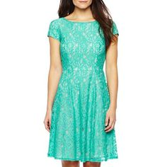 You'll be noticed in this feminine dress featuring cap sleeves, lace detailing and an exposed zipper