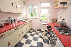 I'm dying over the kitchen cabinets in this 1930s art deco property in Gidea Park, Romford, Essex