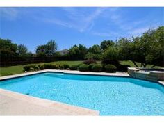Half+ acres lot with mature trees enhance the beauty of the sparkling swimming pool and spa.