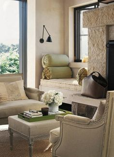 Interior Design Inspiration. Lovely chairs & ottoman. Love the Stone fireplace & the window seat for the perfect reading nook.