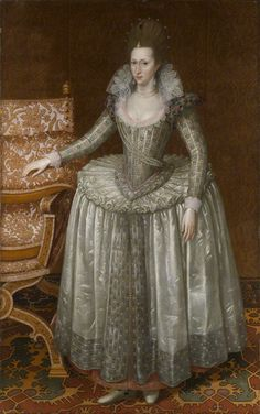 Anne of Denmark ; John De Critz the Elder. This portrait shows the Queen in the fashion evolving from1605 onwards. Sleeves have become very tight, the bodice has been cut lower & the French farthingale has diminished in width. Hair is now dressed to an exaggerated height. The Queen still favours the flat shoe associated with the earlier style. In 1605 the Queen would have been 31; she obviously retained an interest in fashion but she would not necessarily have been bang up to date.