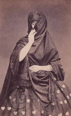 """La Tapada Limeña, The veiled women of Lima, Peru. 19th century 'La Tapada Limeña, full of grace and beauty, were known universally by that name because of their celebrated attire, """"la saya y el manto"""". This attire consisted of a skirt and a black cloak that women would hold gracefully over their face, coquettishly leaving one eye uncovered. Such original attire allowed """"las limeñas"""" to go out alone and to start a conversation with whomever they pleased, without damaging or compromising…"""