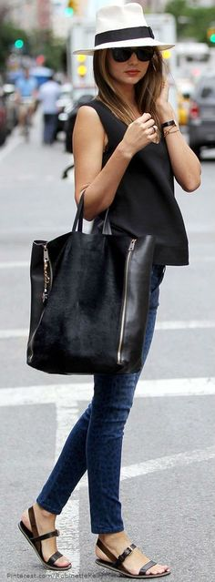 Black handbag, black short top and blue jean...except way cuter shoes