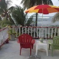 Rainbow Beach Apartments  Rooms Calibishie Located in Calibishie, Rainbow Beach Apartments  Rooms offers a restaurant and a private beach area. This self-catering accommodation features free WiFi. The apartment will provide you with a cable TV and laptop.
