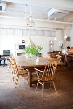 Really like the mix of sidechairs and armchairs. Repin: Coffee Shop ideas