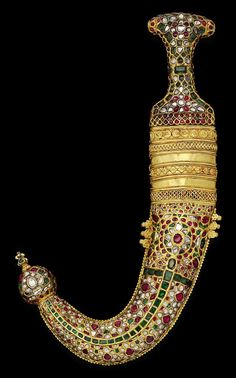A jewel-encrusted gold-mounted dagger (jambiyya). Yemen and India, late Swords And Daggers, Knives And Swords, Ancient Jewelry, Antique Jewelry, Renaissance Jewelry, Antique Silver, Arm Armor, Photos Voyages, Cold Steel
