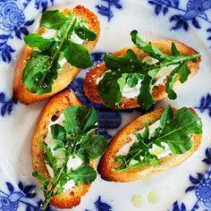 This Fresh Arugula Bruschetta is an easy-to-eat party food. Recipe: http://www.bhg.com/recipe/appetizers-snacks/fresh-arugula-bruschetta/?socsrc=bhgpin061512