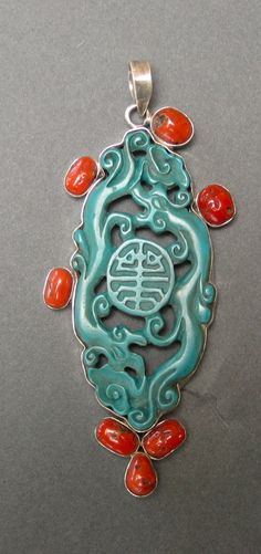 Sterling, turquoise and coral pendant