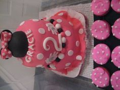 2 Year Old Minnie Mouse Style Tiered cake with matching Cupcakes  By: vrhg1958