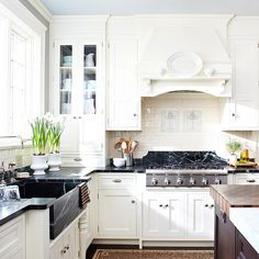 We love the soft white cabinetry in this bright, family-friendly kitchen.