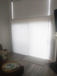 We installed this Motorized Indoor Roller Shade and Vertical Sheer Shade combo on a window and sliding door in Laguna Niguel, California.  This is a great display of the variety of our options for Window Treatments! Whether you need blackout material or translucent material, we have your back.  Go over to www.chiproducts.com/residential to take a look at all of the many options available for your customization.
