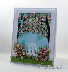 I had so much fun this morning making this handmade garden scene with die cut birds and flowers.  I had all of these dies left left over on my desk from making