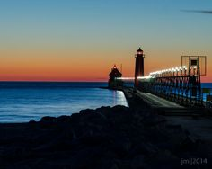 Grand Haven Pier and Lighthouse at Sunset by JMLeachPhotography