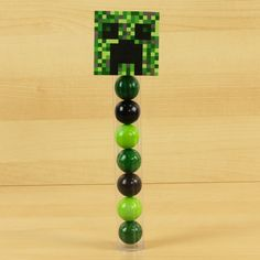 These gumball tubes come with lime green, watermelon, and black gumballs. This gumball tube is made for our Minecraft Printables. Purchase separately and Downlo