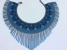 Gorgeous seed bead collar necklace. Beautiful color combination that will go with everything. Simple elegance, yet makes a statement. Looks