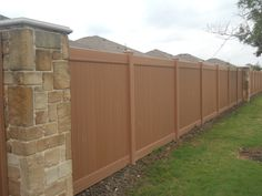 Redwood Wood Grain Vinyl Fence from Future Outdoors.  Maintenance free, life time warranted, quality in the material and installation.  DFW Area 972-576-1600