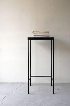 black metal thin stool