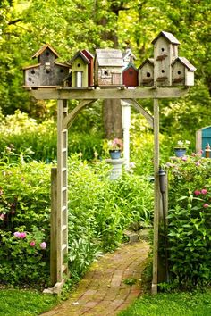 Birdhouses stacked on trellis