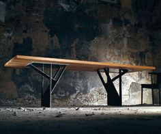 'Steel. Wings' is a dining room table which is composed of a solid timber table…