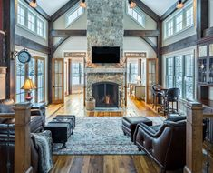 The family room in our Ironwood house plans is loaded with natural light. Visit to see more on this amazing home. #barnhomes