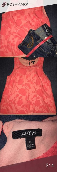 Coral colored tank top - medium Perfect for summer! This tank top would look great with some denim cropped pants! Could even be matched up with some black capris for a more work specific look! Length hits below the waist! Let me know of any specific questions! Tops Tank Tops