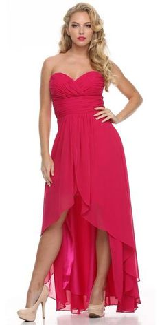 Perfect for a bridesmaid dress, this high low dress in coral flaunts a strapless look that is nicely complemented by a sweetheart neckline. A charming ruching pattern graces the fitted bodice in an overlapping manner and is further highlighted with a ruched belt on the empire waistline. A layered skirt with asymmetrical hems accentuates the overall appeal of this gorgeous dress. Designer: Juliet Item number: 551 Material: Chiffon. 100% polyester. Fully lined. Soft cup padded inserts. Corset…
