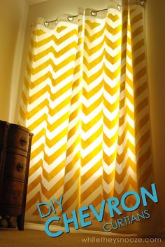 DIY Chevron Curtains Tutorial. Instead of paying big bucks for new curtains, this blogger used old plain curtains she already had, fabric paint, a foam roller and painters tape to add chevron stripes to spruce them up.