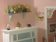 """1:12 SCALE MINIATURE ROOMBOX BASED ON THE CHILDREN'S ROOM FROM THE MOVIE """"HOOK"""" WITH ROBIN WILLIAMS & DUSTIN HOFFMAN Shelf was a rountable kit, clock by Brooke Tucker, teensy cabin built by my SIL, and it's LANDSCAPED!"""