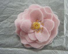 felt flower in pale pink, yellow button center