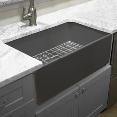 blanco ikon silgranit apron front farmhouse kitchen sink blanco is pleased to introduce the worlds first apron front sink made of natural gran - Kitchen Sinks Granite Composite