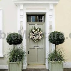Gorgeous greyed sage door (try Farrow and Ball French Gray for similar) flanked by two half-standard topiary trees and a pretty wreath on the door #latex #sexy #ladies #women #latexskirt #latexdominate #latexboss #shiny #fashion #latexshopping #buylatex #skirts
