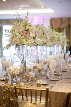 Lavish head table floral decor in white and blush using orchids, roses and hydrangeas, by Eliana Nunes Floral Design | Romantic Wedding Reception at Grandover Resort.