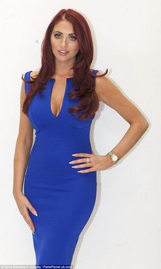 8ed4fe348d495 Amy Childs displays her ample cleavage as she models her collection