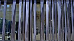 Biblioteca de Sant Antoni.    biblioteca de Sant Antoni. Barcelona. RCR Arquitectes (Aranda, Pigem y Vilalta) Wall Exterior, Exterior Design, Facade Pattern, Compound Wall, Wood Facade, Organic Structure, Boundary Walls, Sliding Gate, Decorative Wall Panels