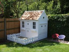 Fenced decked area to front of childrens wooden playhouse