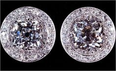 QUEEN MARY CLUSTER EARRINGS Made for Queen Mary in 1922 of a central large diamond surrounded by two rows of diamonds set in platinum with millegrain edging.