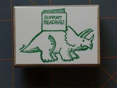 """BERNARD MOST """"TRICERATOPS ~ SUPPORT READING"""" RARE DINO RUBBER STAMP"""