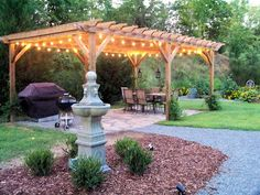 Lovely backyard pergola with lighting. I would add wisteria and roses. Just need to make sure to do lots of pruning -- or hire someone to do it (which is more likely!)