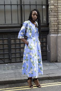 Pin for Later: 43 Chic Summer Outfits That Are Perfect For 30-Somethings A retro floral dress with a matching jacket