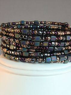 Black and blues industrial metallic cube beaded cuff bracelet, memory wire bracelet in oil slick colors of blacks, blues and bronzes