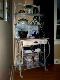 I'd love a bakers rack like this- perfect spot for all my tea things (and the toaster too).  Because seriously, my tea has taken over too much counterspace.