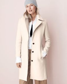 How we do classic at J.Crew. It's all about those pieces you'll still be wearing in 10 years. First up… The double-cloth belted trench coat in vintage champagne.