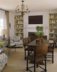 sitting area and reading nook in dining room. Way to actually use dining room. turn dining table and put reading nook in bay window. cozy.
