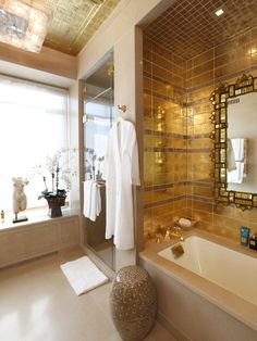 Golden tiles adorn in a bathtub enclosure at Ritz Carlton Hotel Central Park, New York City Two Bedroom Apartments, Luxury Apartments, Luxury Homes, Kb Homes, Bathtub Enclosures, New York City Apartment, Penthouse Apartment, Penthouse Suite, Top Interior Designers
