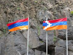 The flags of Armenia (left) and Nagorno Karabakh (right) fly together at the highway border crossing between the two countries. Flying Together, The Republic, Armenia, Flags, Countries, Two By Two, Outdoor Decor, National Flag