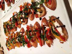 Burrata crostini with roasted peppers, basil and balsamic glaze