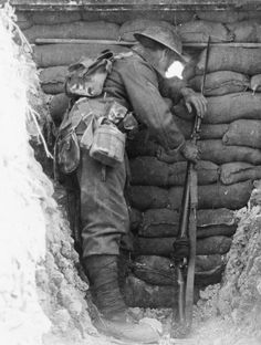 BATTLES SOMME 1 JULY - 18 NOVEMBER (Q 4100)   Worcestershires in the trenches at Ovillers. Sentry looking out through a loop-hole. August 1916.