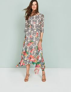 Ladies, meet Beatrix. Florals inspired by the Japanese lotus flower bloom across luxurious 100% silk chiffon, with our Boden-exclusive Wild Bloom print layered over the top in a graduated design. A hanky hem gives this piece an effortless, ethereal vibe, while the high neckline and three-quarter-length sleeves ensure a modern finish. Poly georgette lining creates a lightweight feel that won't cling. It doesn't take much to style this dress; simply add our Icons Aleta Tie Back Heels.